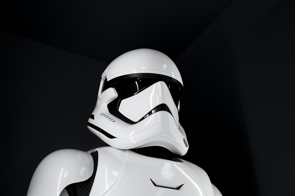 white and black helmet on black surface