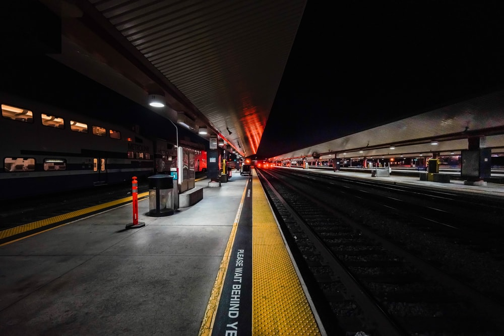 time lapse photography of train station during night time