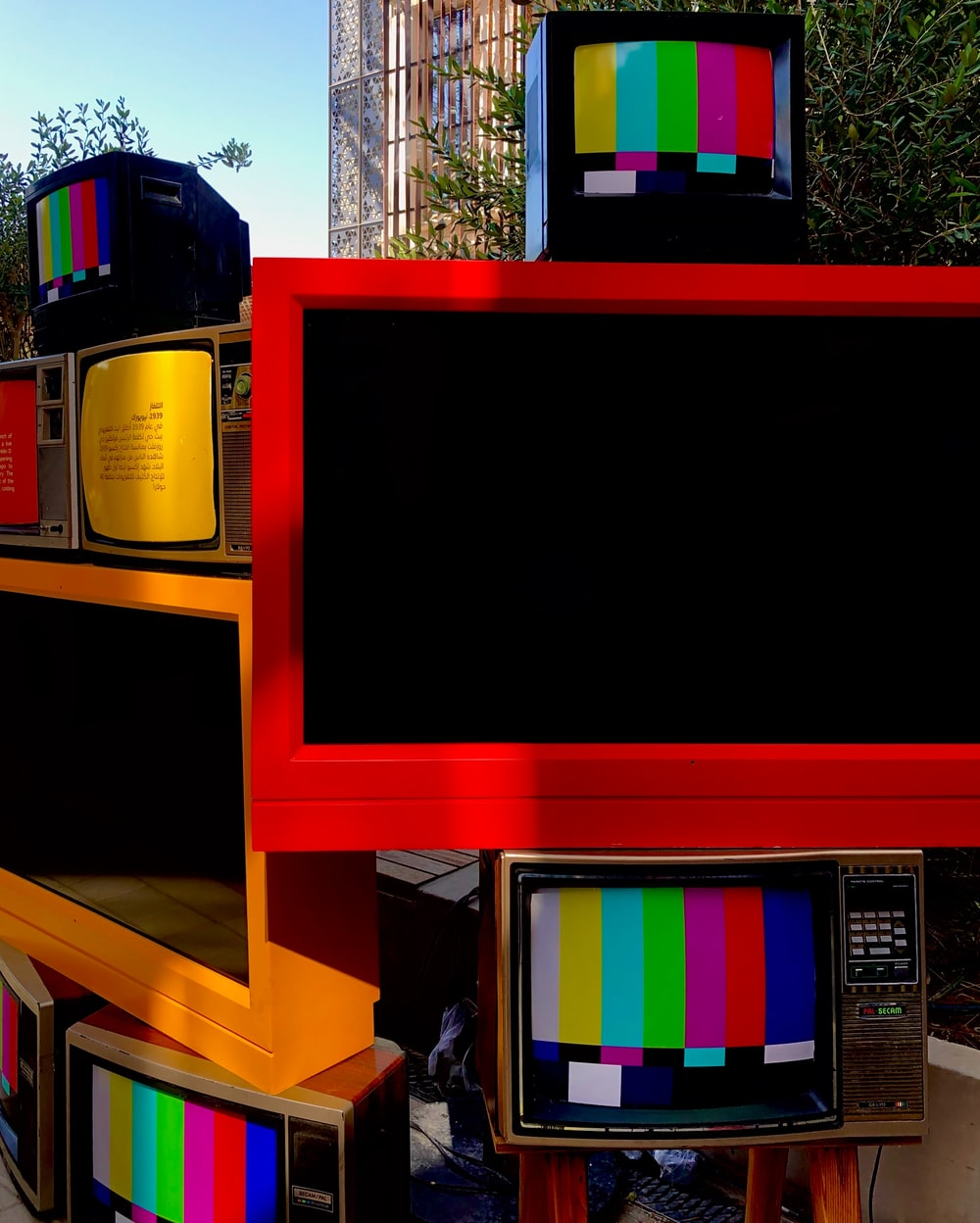 black flat screen tv on brown wooden tv hutch