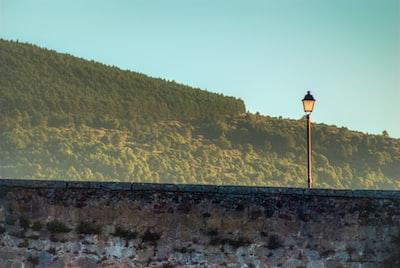 lamppost over stone bridge