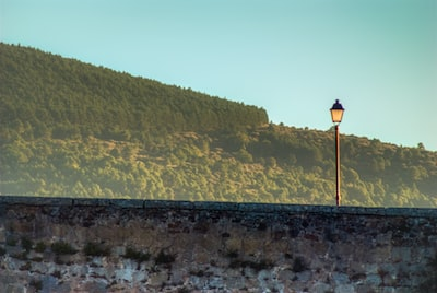 lamppost over stone bridge
