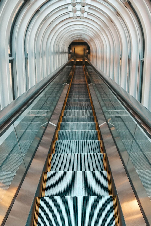 black and silver escalator in a train station