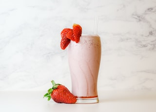 strawberry shake in clear drinking glass