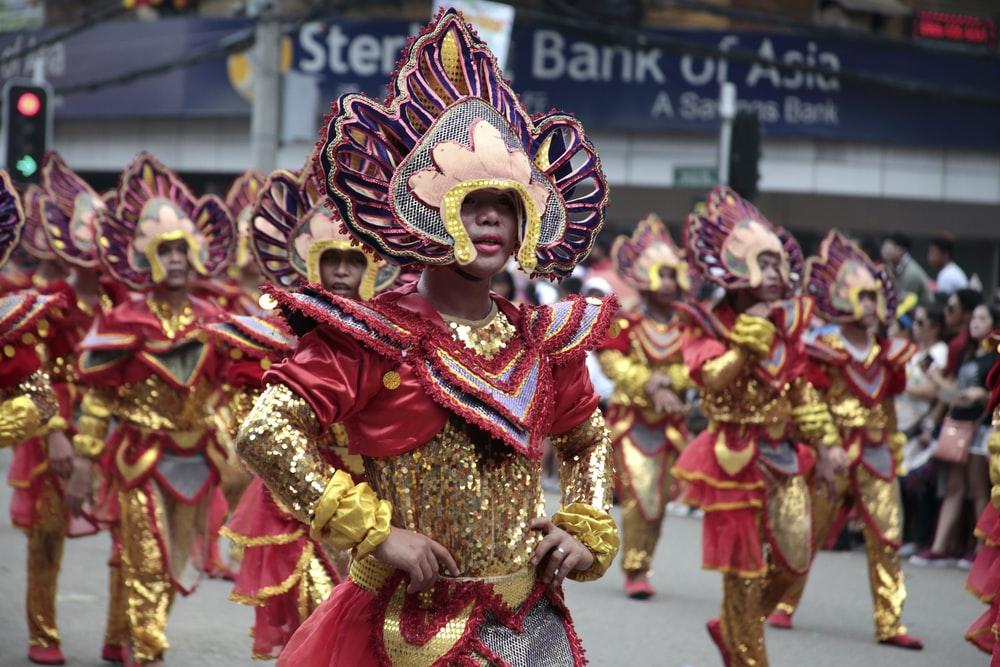 people in red and gold traditional dress