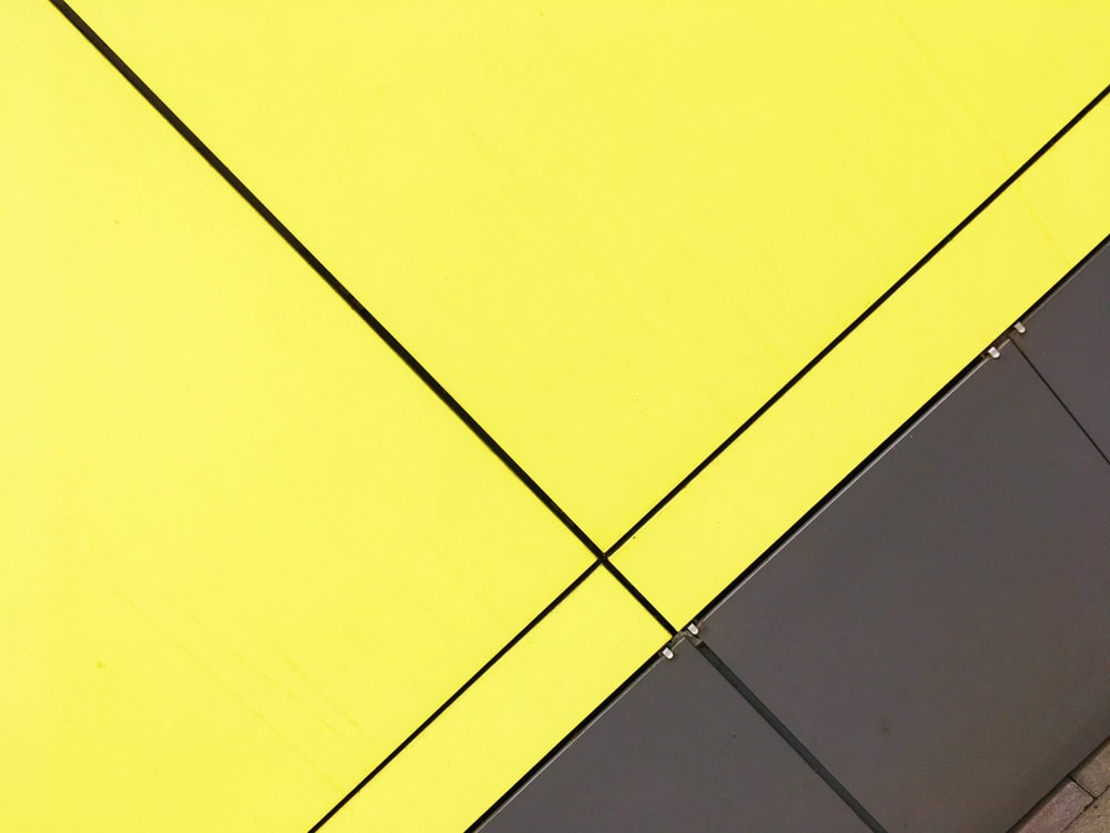 yellow and black wooden board