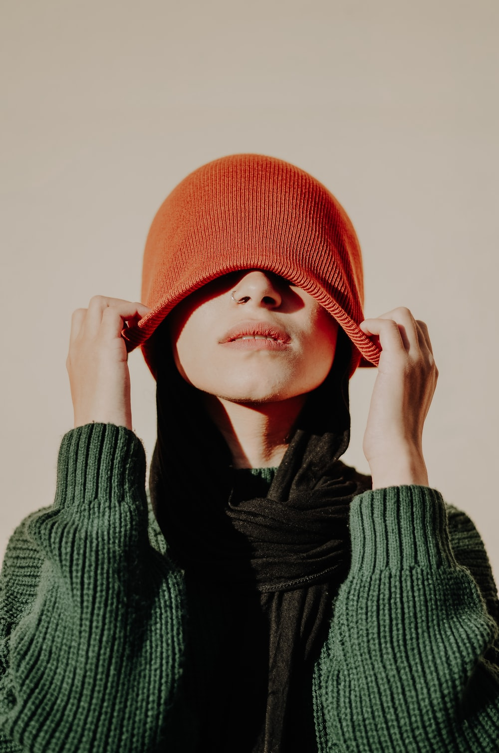 woman in red knit cap and black scarf