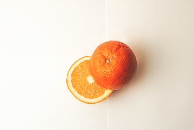 orange fruit on white surface orange teams background