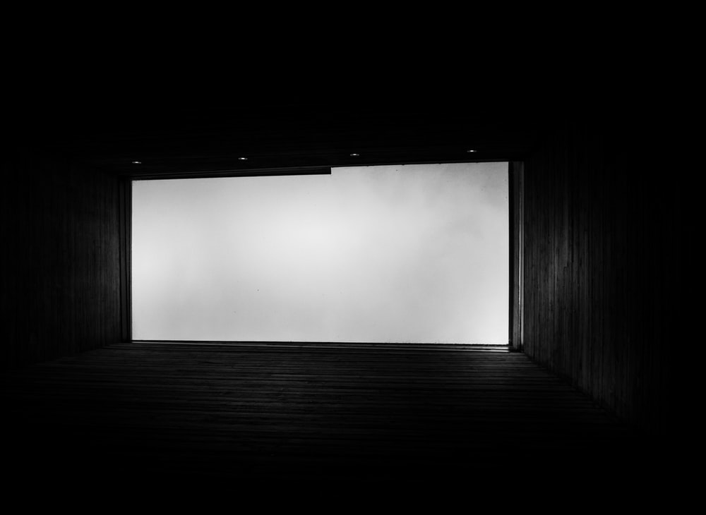 black wooden hallway with white fog
