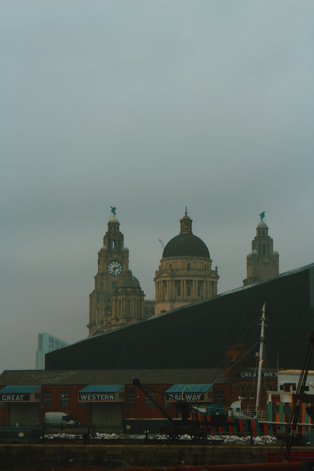 brown and black dome building under gray sky