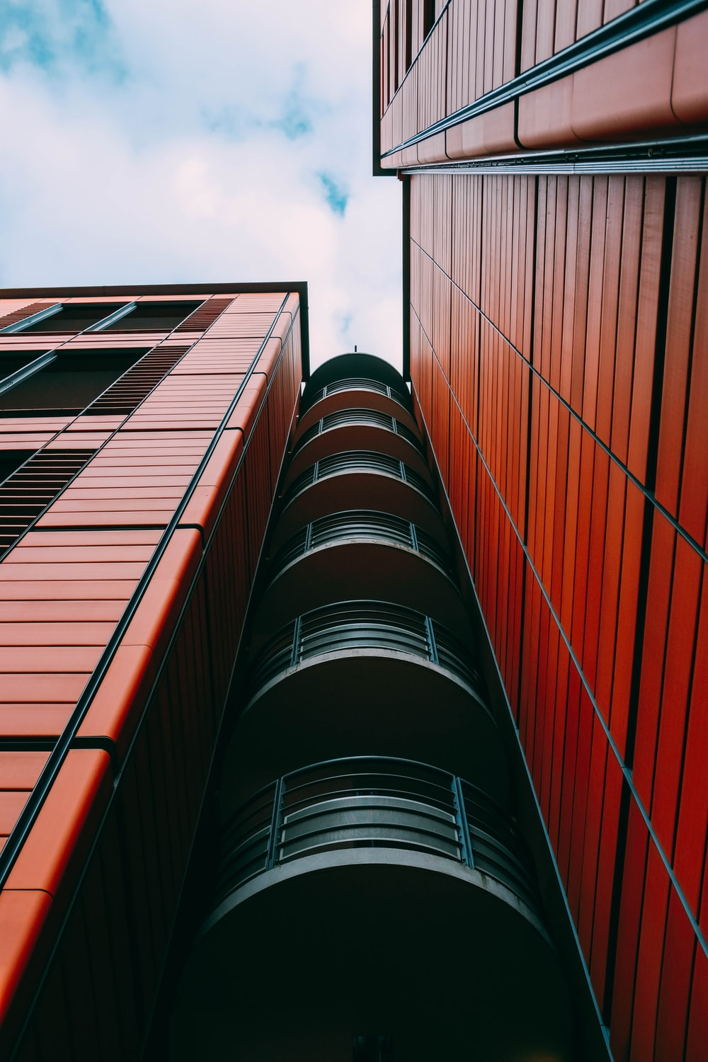 black and red building under blue sky