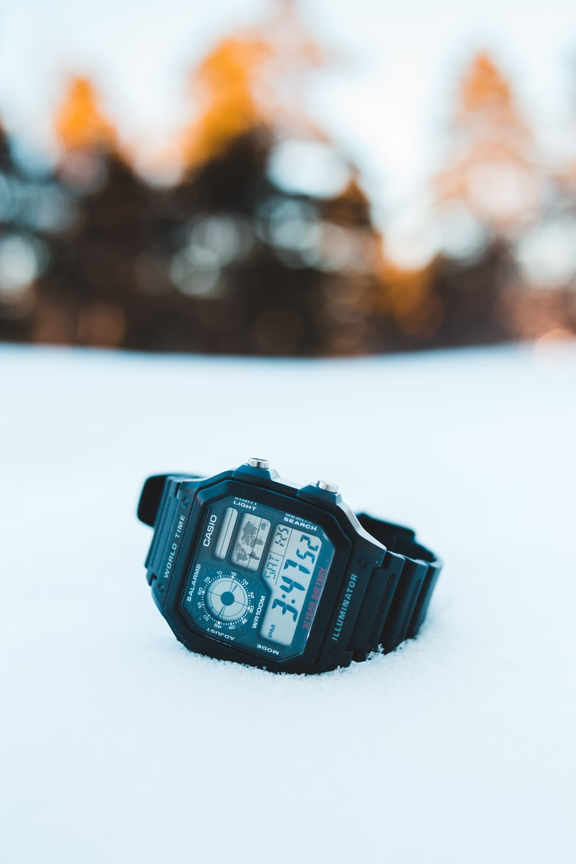 black casio digital watch at 10 00