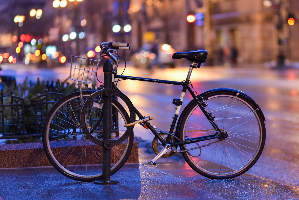 black bicycle on gray concrete road during night time