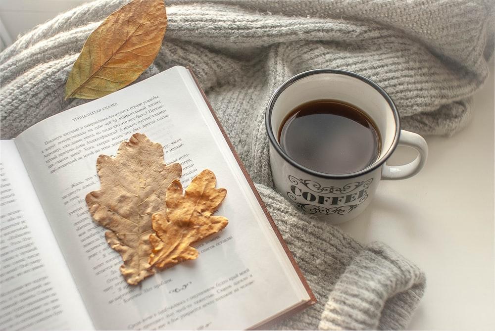 brown chips on white paper beside white ceramic mug