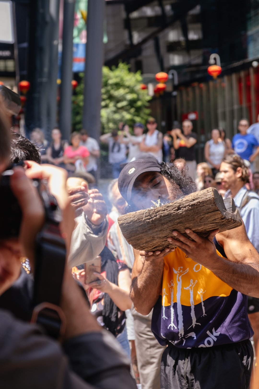 Invasion Day rally, a man light up a fire the traditional way