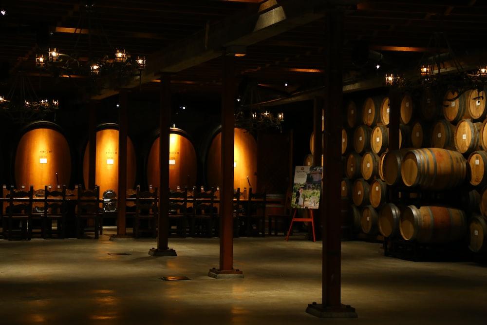 brown wooden barrels on brown wooden floor