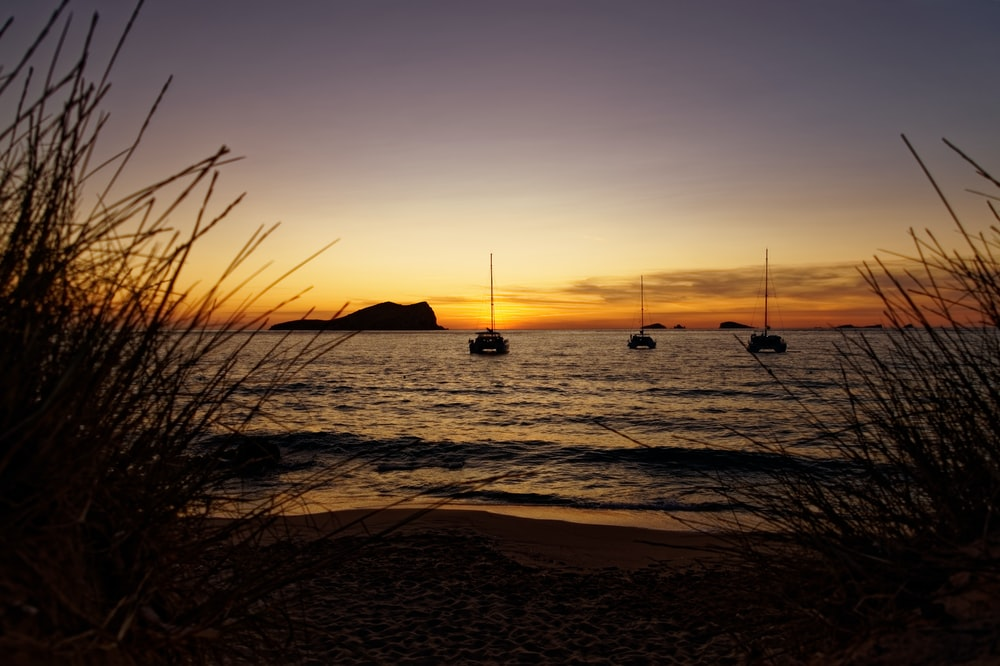 silhouette of boat on sea during sunset, Sunset, Ibiza, Ibiza with kids