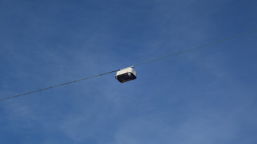 white and black cable car under blue sky during daytime