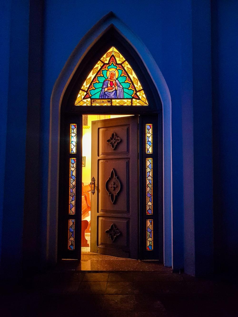 brown wooden door with glass