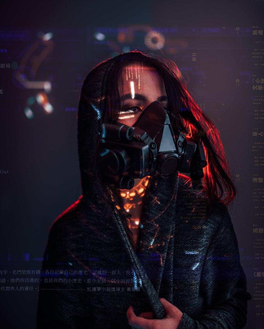woman in black leather jacket wearing black mask