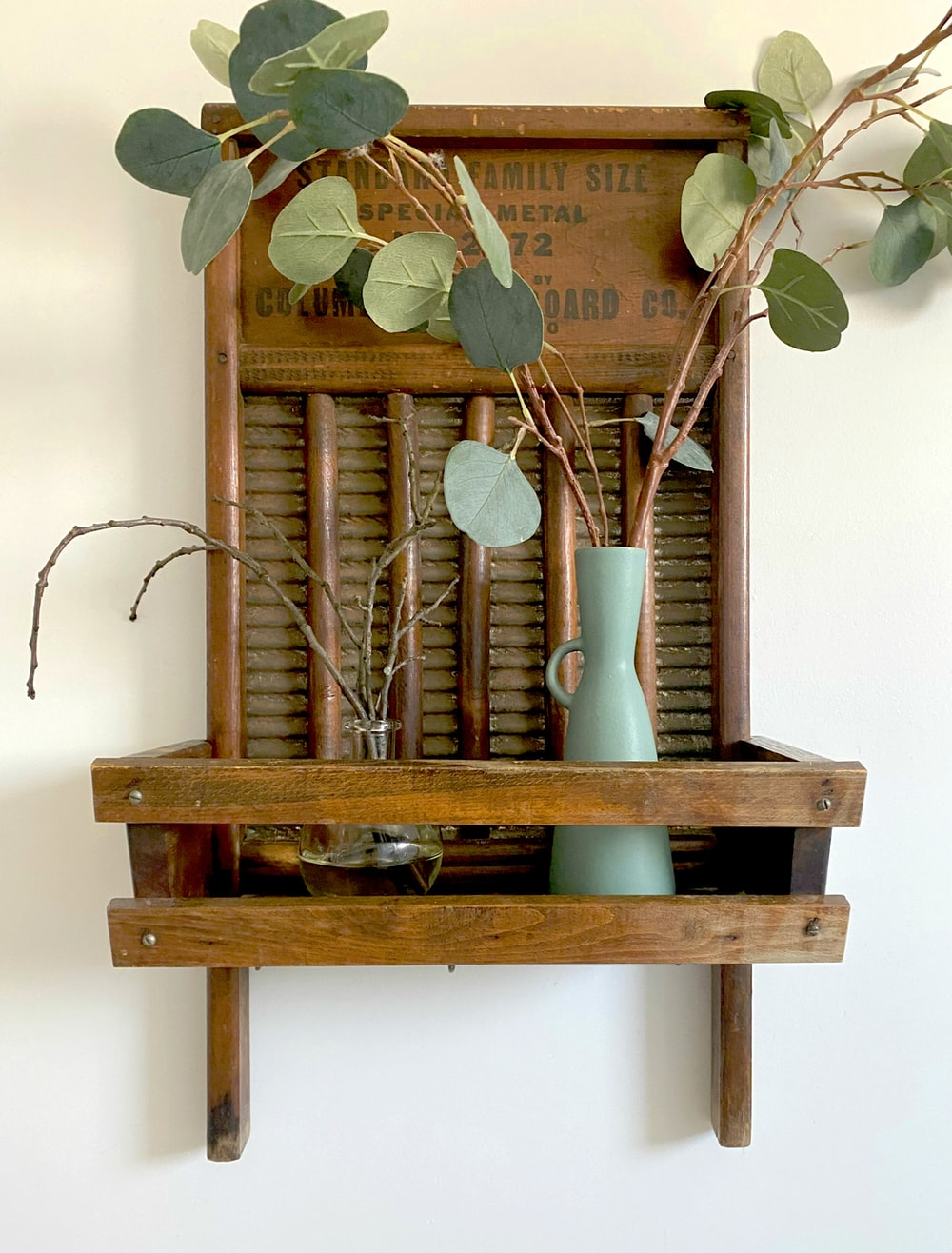 brown wooden wall mounted rack with green plant