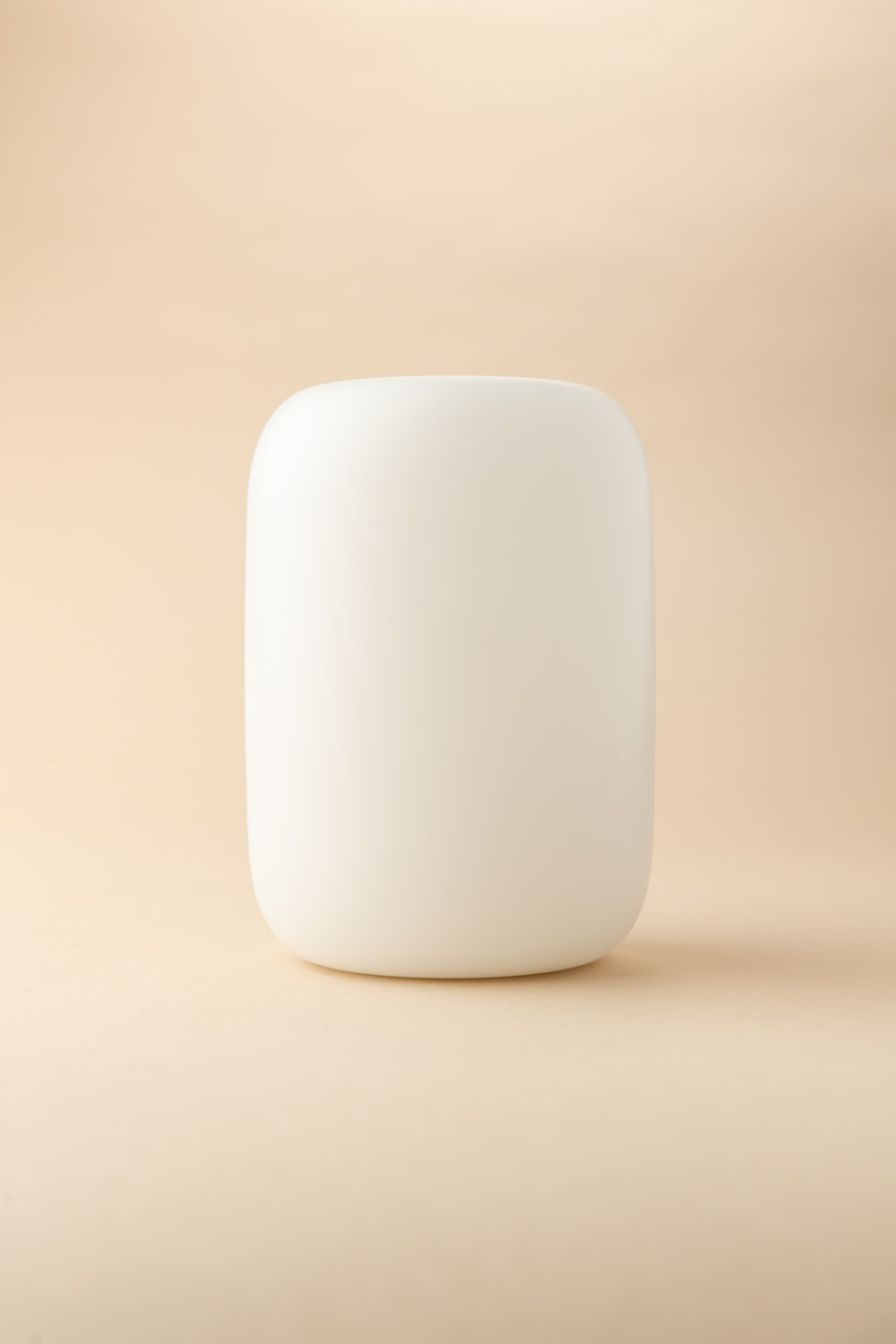 white plastic container on white table