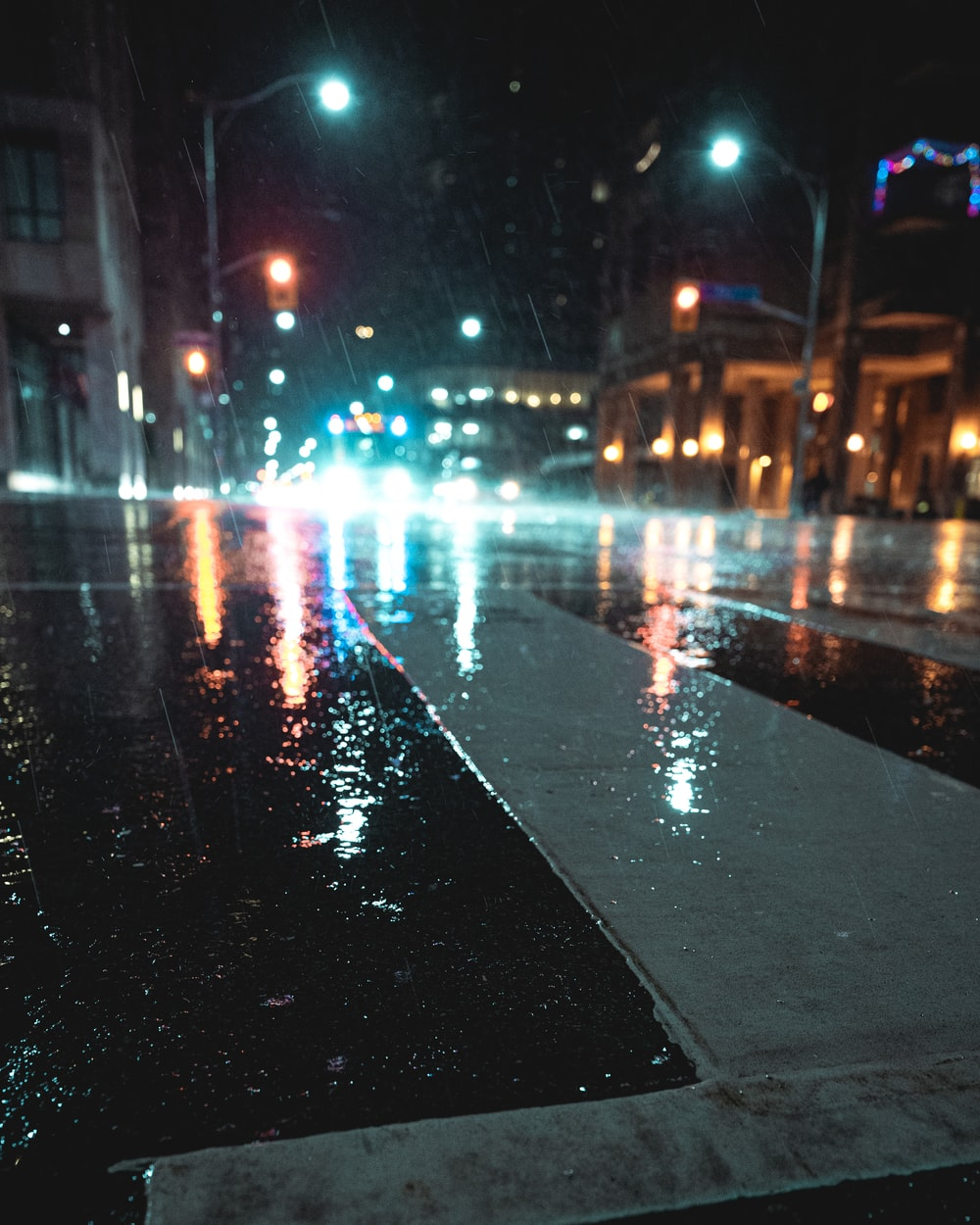 black asphalt road with cars during night time