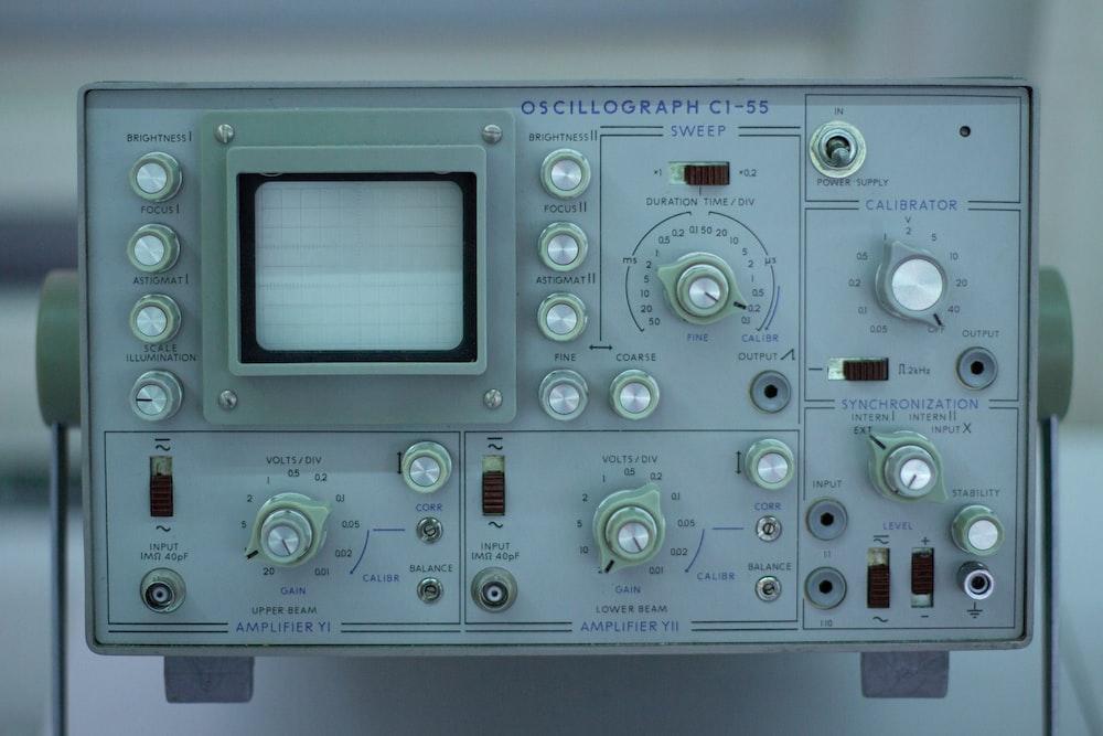 white and green audio mixer