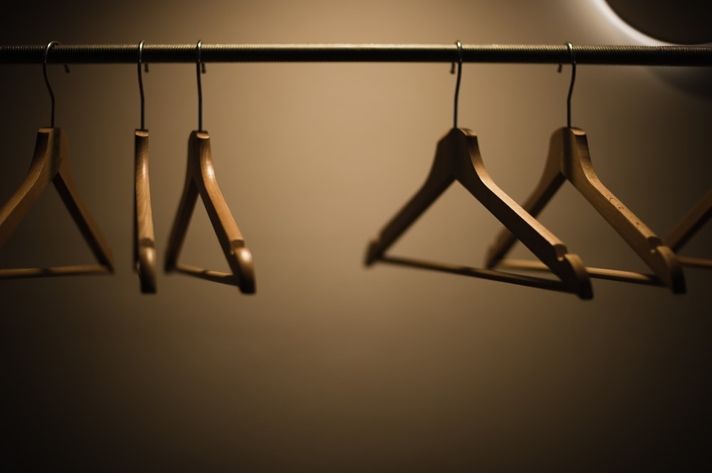 clothes hanger on black metal rack