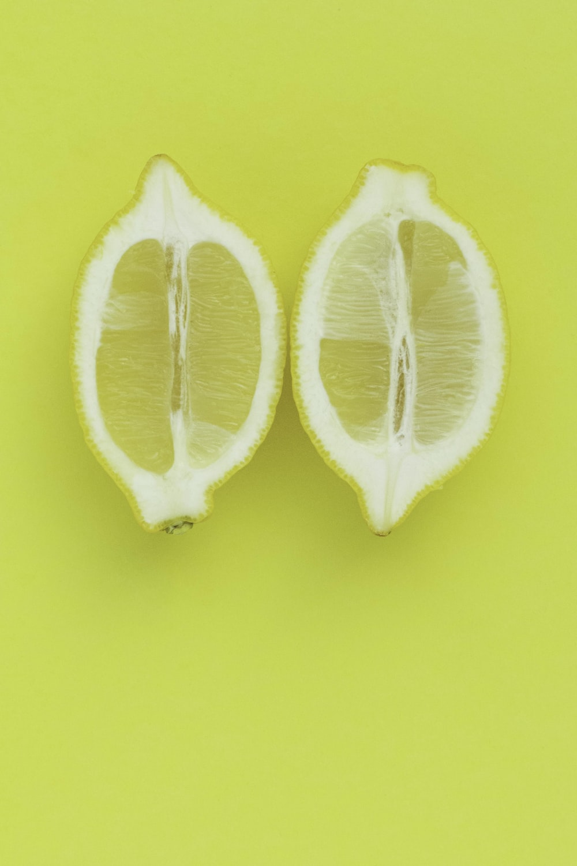 3 sliced lemon on yellow surface