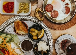 brown wooden round tray with foods