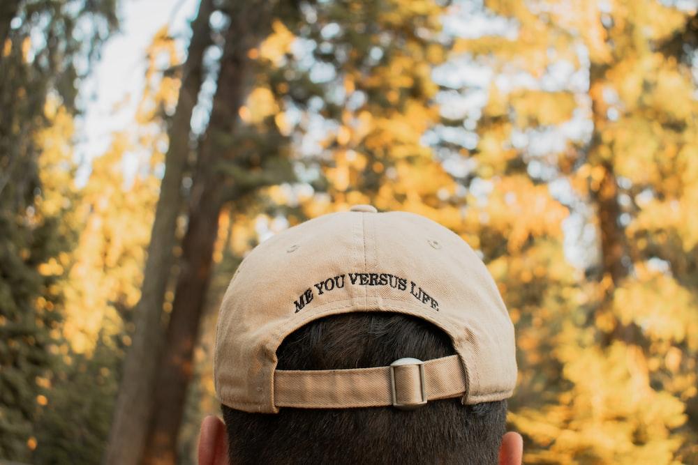 man in brown and black cap