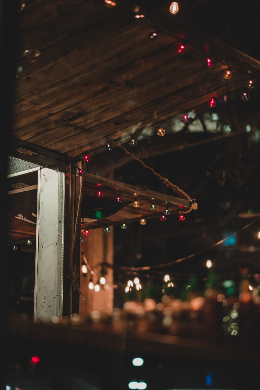 string lights on brown wooden wall