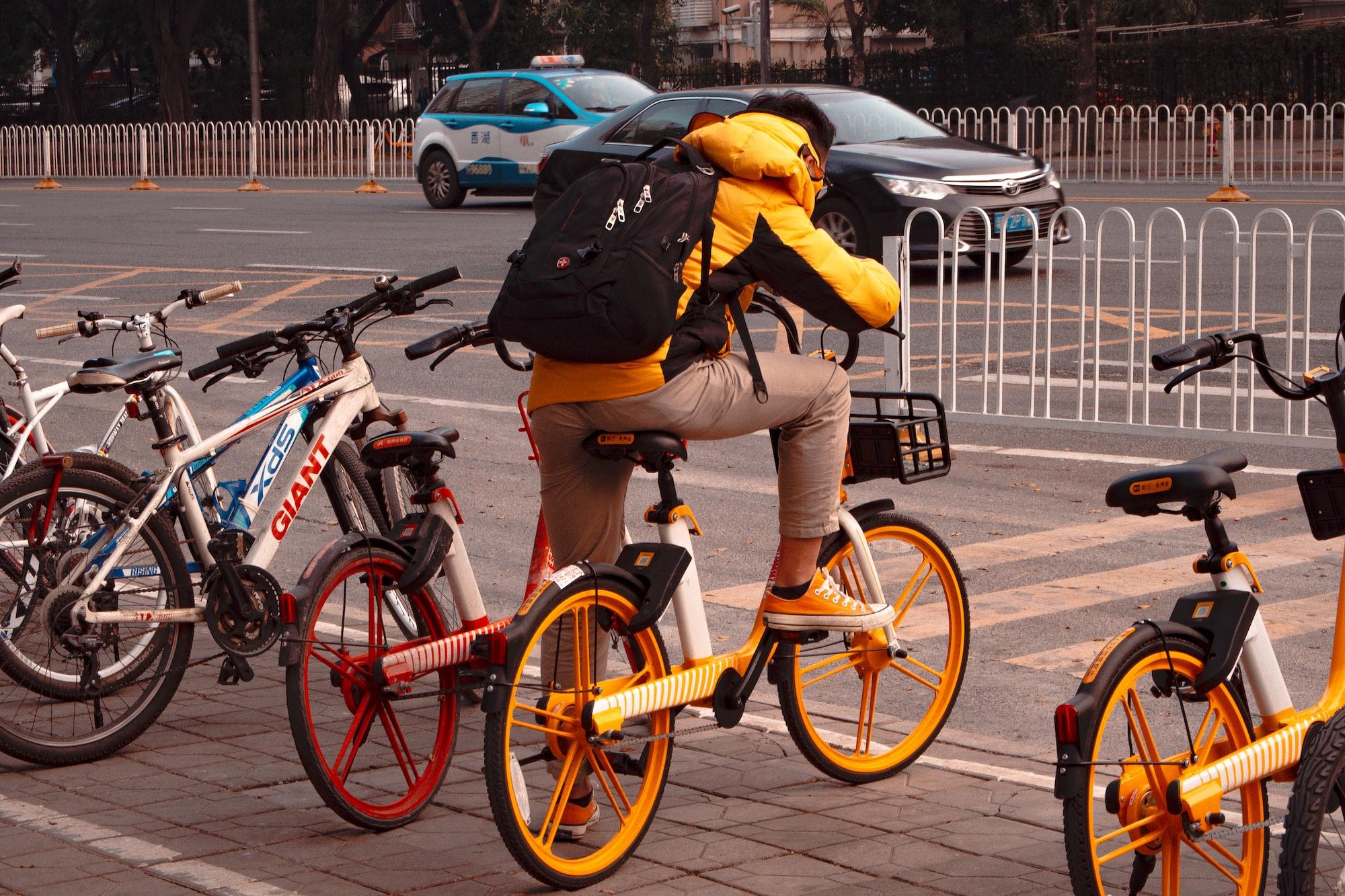 Man on shared bike in Shenzhen, China.