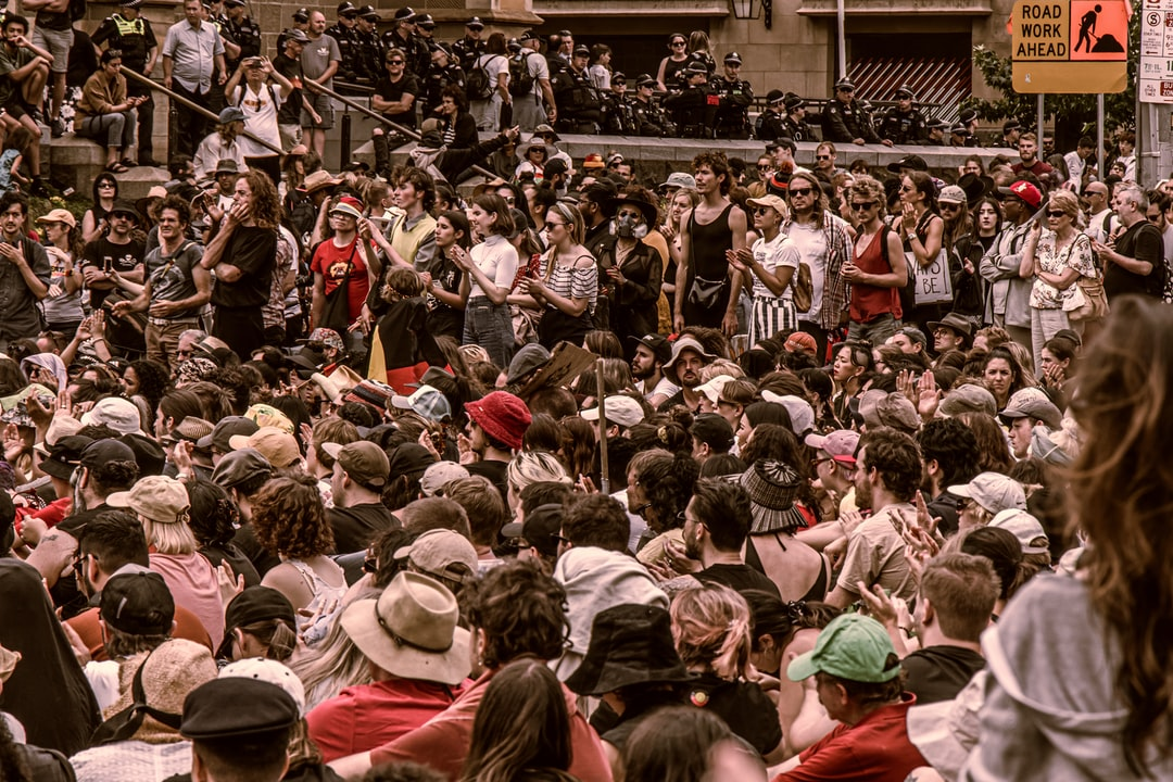Australia Day/Invasion Day protest at Flinders Street Station Intersection. The protest also mentiones topics about bush fire and climate change.  I use high contrast, warm color and low saturation to reflect the black, red and yellow color on the aboriginal flag.