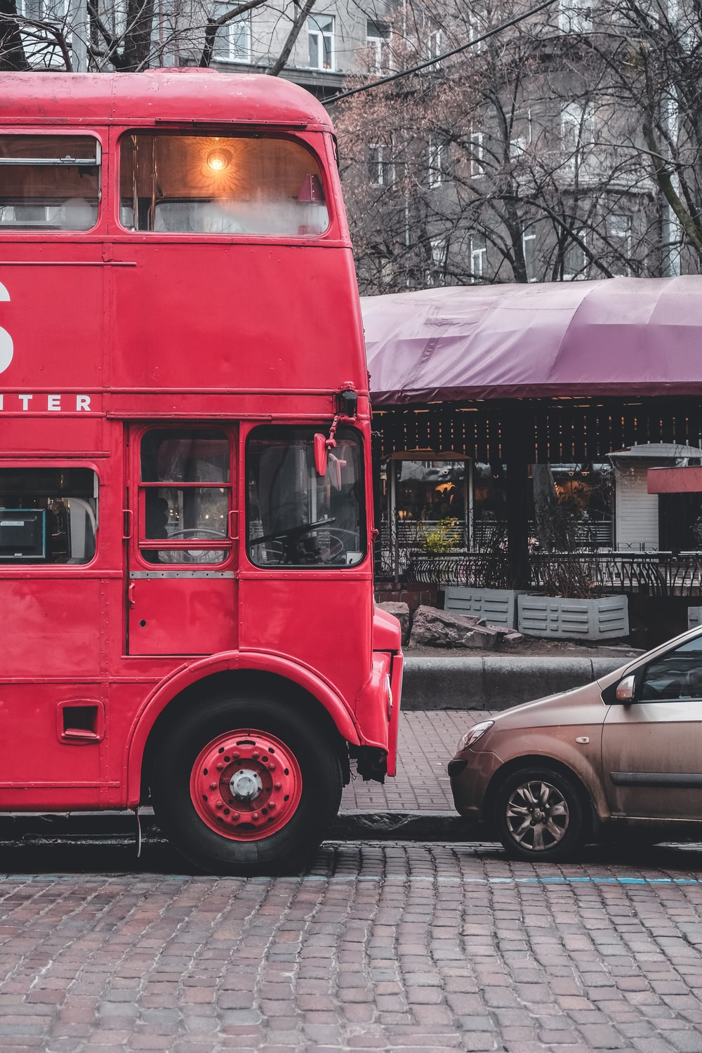 red double decker bus on road during daytime