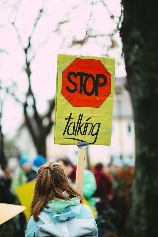 yellow and green no smoking sign