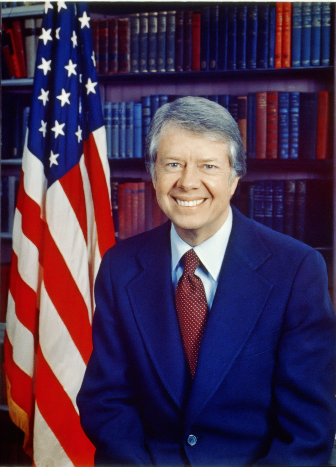 [Jimmy Carter, head-and-shoulders portrait, facing front, next to an American flag]. Photograph by photographer Karl Schumacher, 1977. From the Presidential File Collection. Library of Congress Prints & Photographs Division.  https://www.loc.gov/item/96522672/