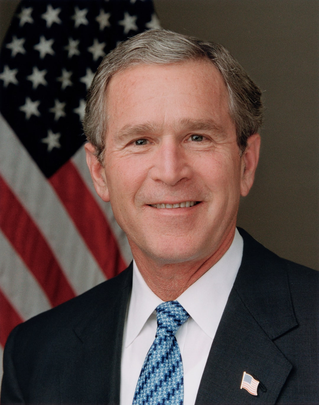 President Bush poses for his official portrait in the Roosevelt Room (blue tie). Digital photograph by photographer Eric Draper, [2003]. Official portrait of President George W. Bush, courtesy of the George Bush Presidental Library. 