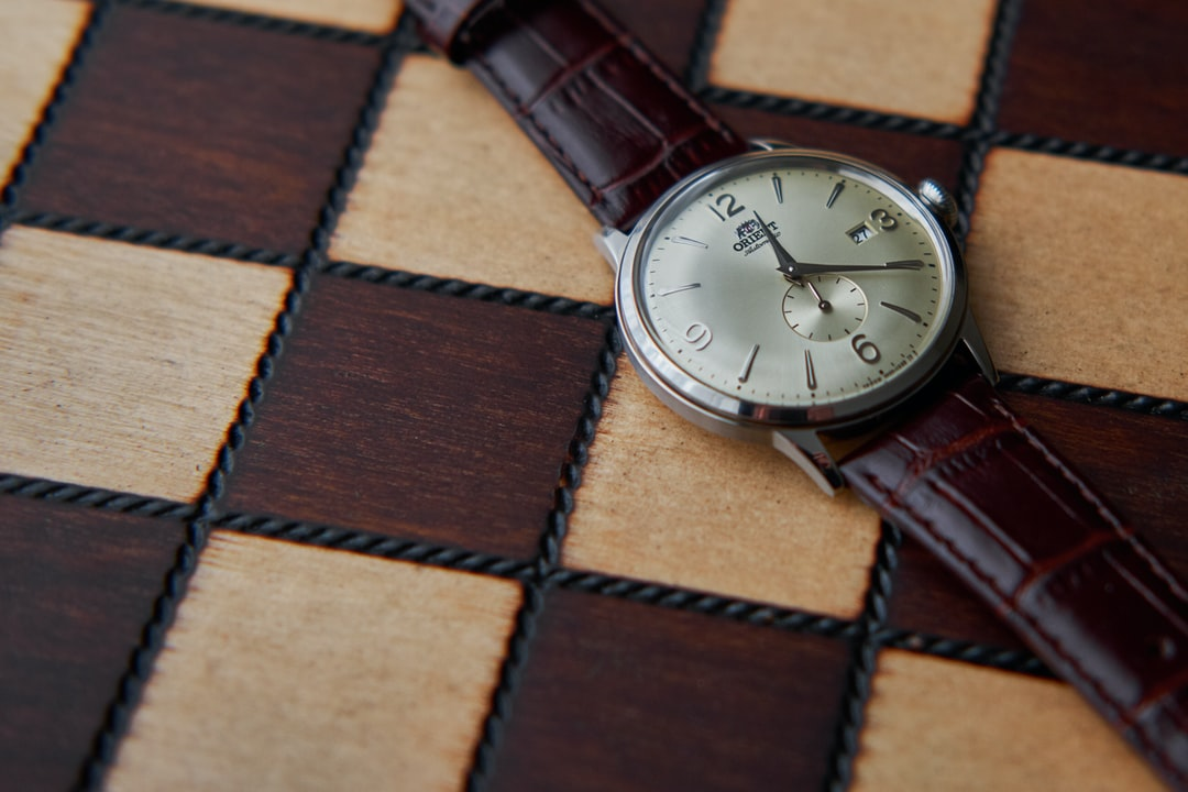 Orient Bambino Small Seconds. wrist watch on chess board.