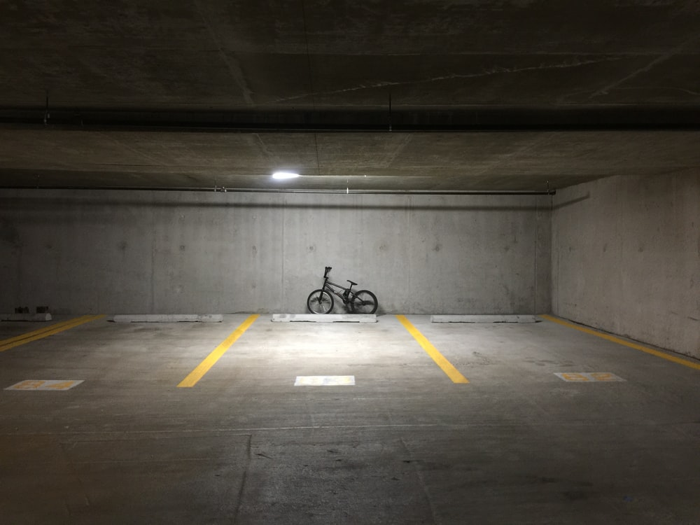 black motorcycle parked on tunnel