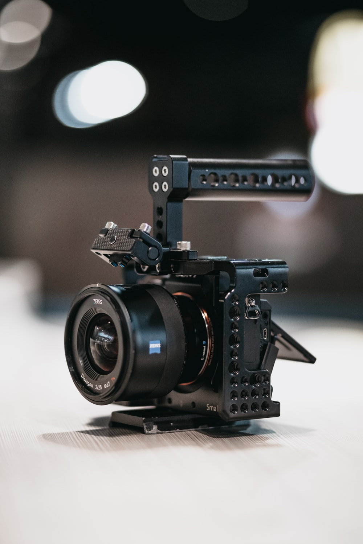 black camera on white table
