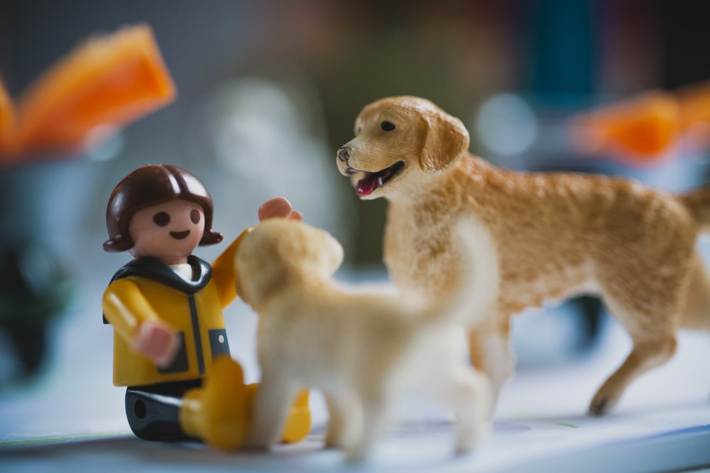 brown dog and yellow dog plastic toys