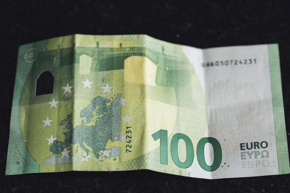 20 euro bill on black surface
