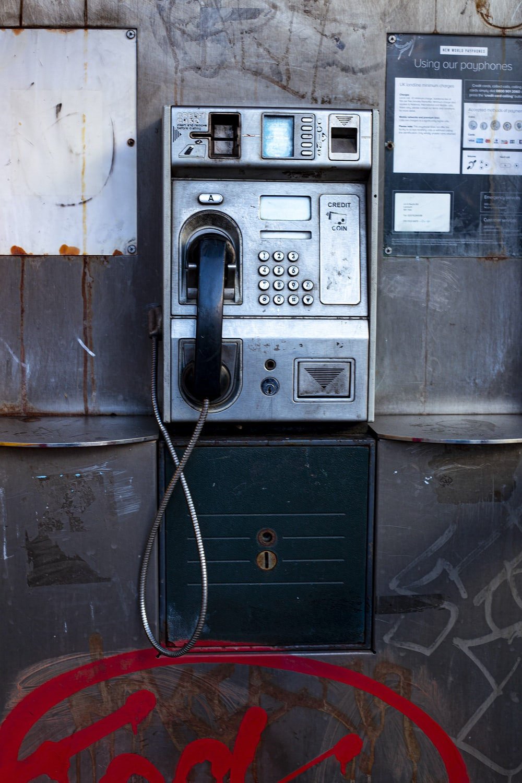 black telephone on black wooden table