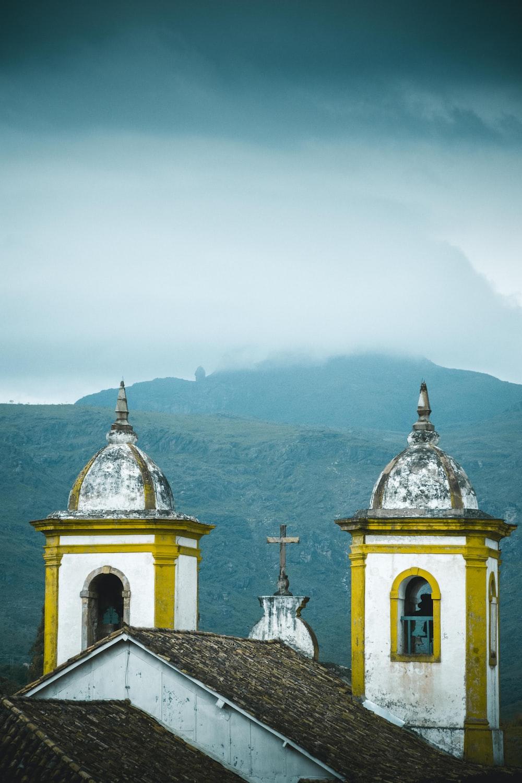 white concrete church on top of mountain