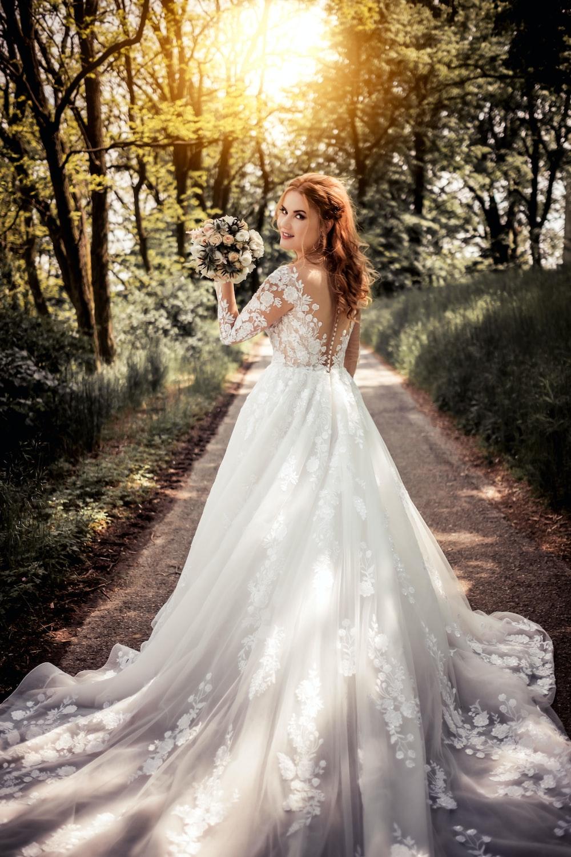edinburgh bride in wedding dress on path