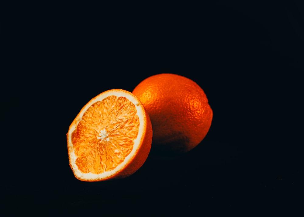 orange fruit on black surface
