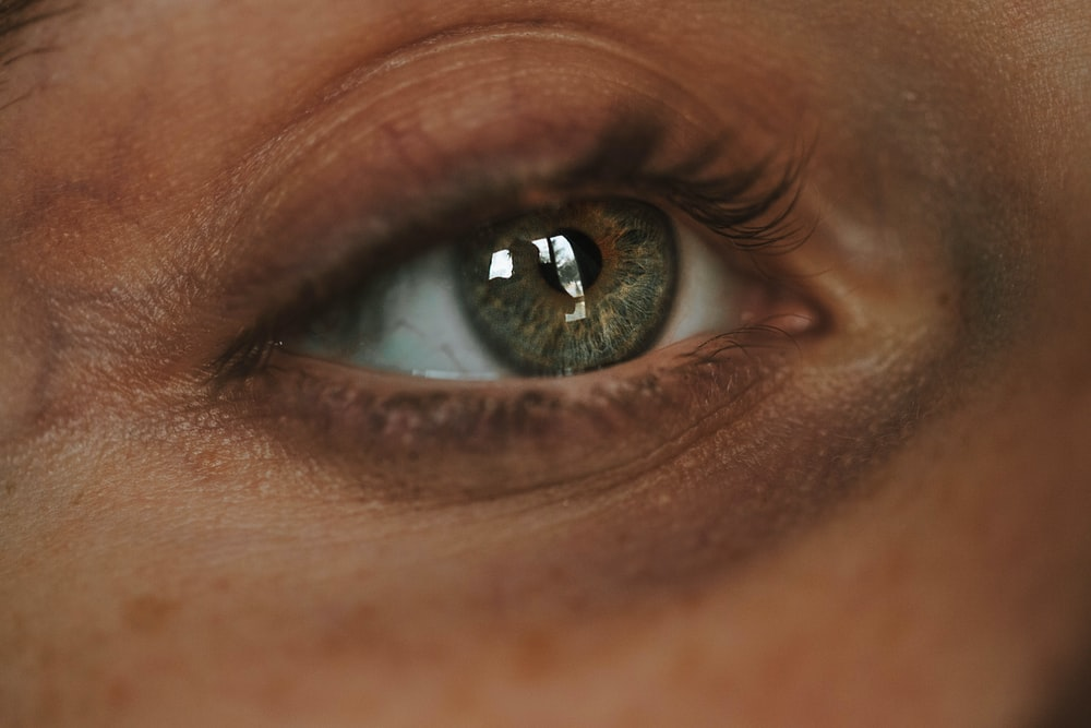 persons blue eyes with green eyes