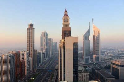 city buildings under blue sky during daytime united arab emirates teams background