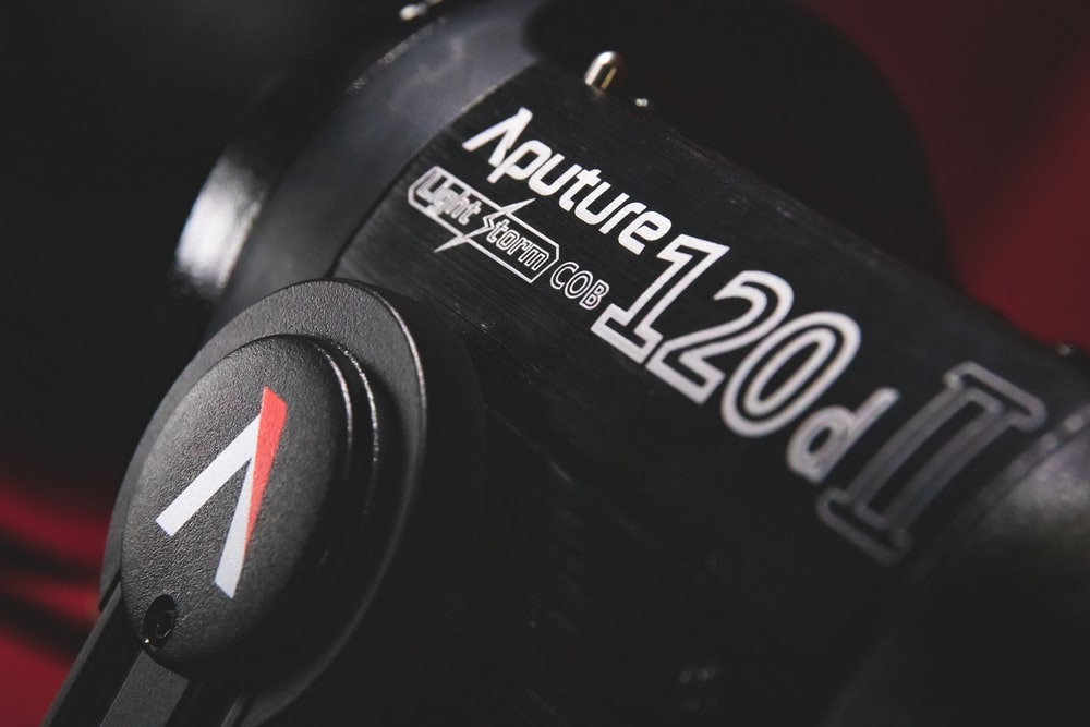 black and red canon dslr camera